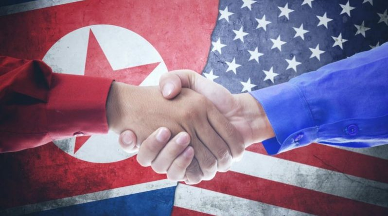 Handshake with North Korea and USA flag